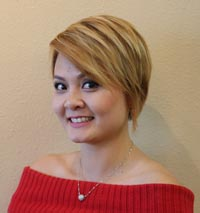 Smiling young woman with blond streaked short hair style
